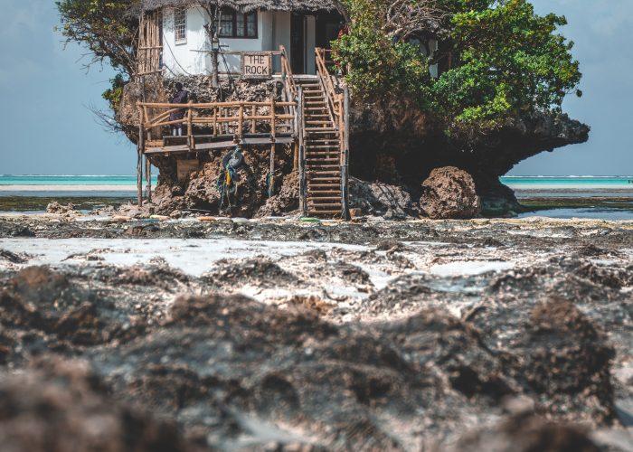 Hut built in rock formation off Zanzibar beach